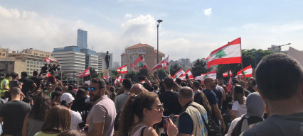 Lebanon announces a new government as protests continue